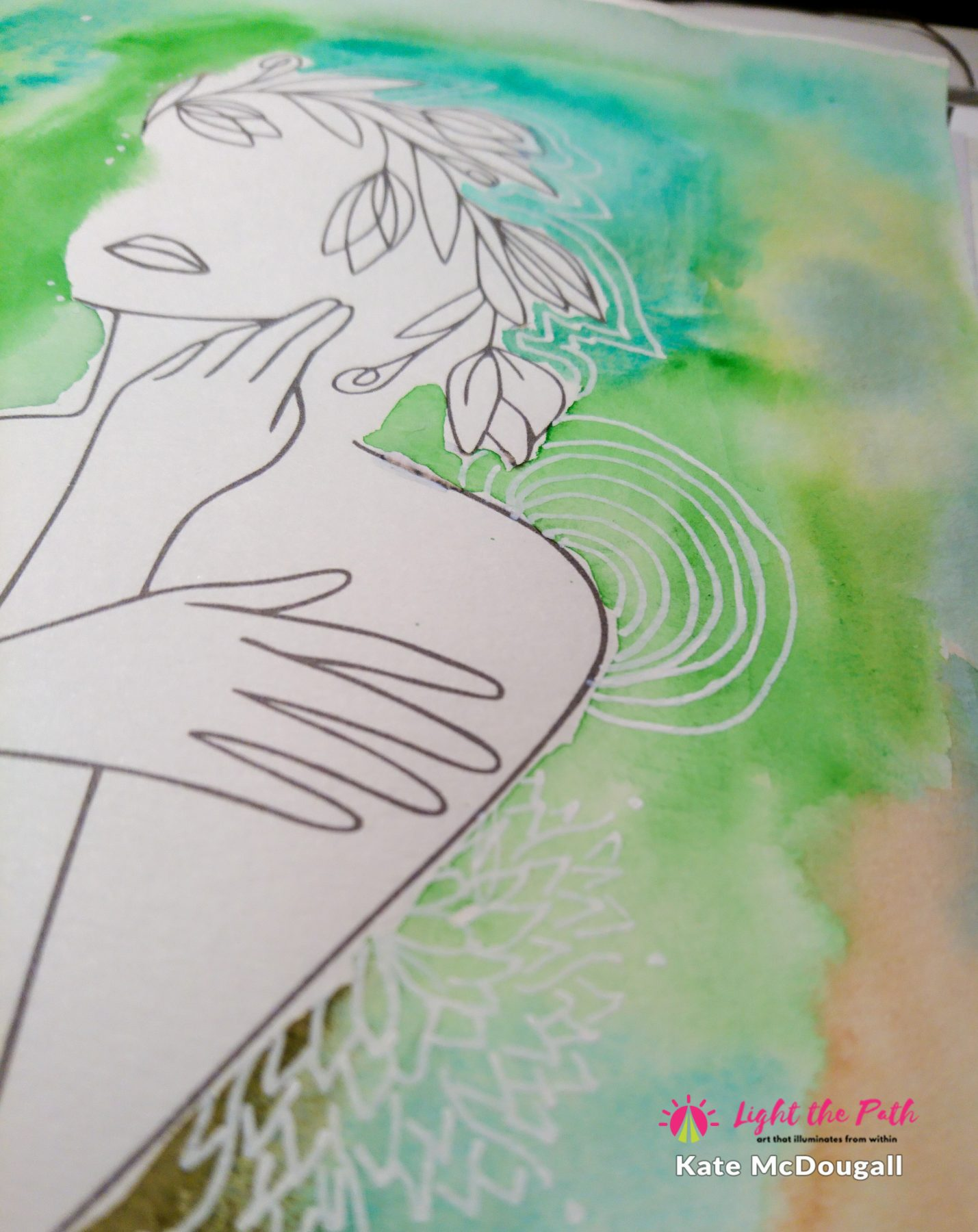An up close image of a watercolour and line art journal page.